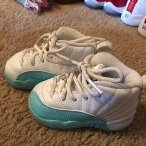 Teal and white Jordans